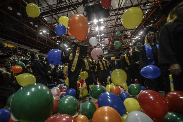 Balloons drop on the new graduates of Broome Community College during the 65th commencement ceremony at the Broome County Veterans Memorial Arena Thursday, May 23.