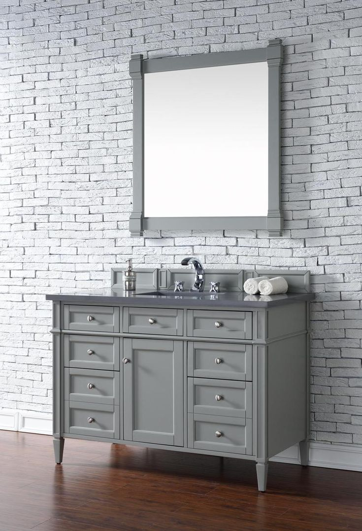 Contemporary 48 inch Single Bathroom Vanity Gray http://www.bathroomvanitystyles.com/lowest-price-grey-bathroom-vanities/ This beautiful piece of furniture includes one hide-away tip out, top row drawer plus two full-depth side drawers, one of which is double-height for storage of taller items. This cabinet also has one door, which conceals an interior shelf, for ample storage. Hand crafted