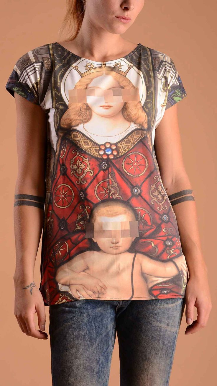 Tee Trend Crew neck T-shirt with Virgin Mary and Baby Jesus print. Front 100% polyester, back 100% cotton.