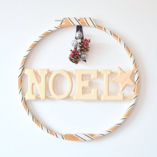 Have any embroidery hoops laying around? Transform them into a wood wreath!