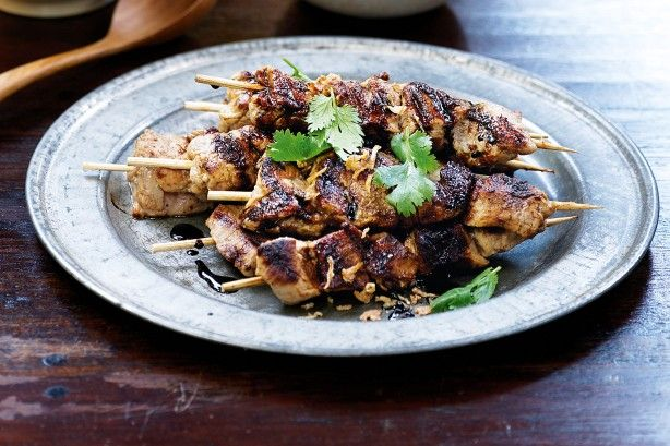 Dip marinated pork into satay sauce that's sweet with sugar, tangy with tamarind and rich in peanuts.