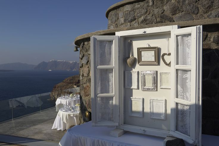 Table plan. An old white window as a beautiful table plan for wedding in Cavo Ventus - Santorini by A la carte Santorini weddings.