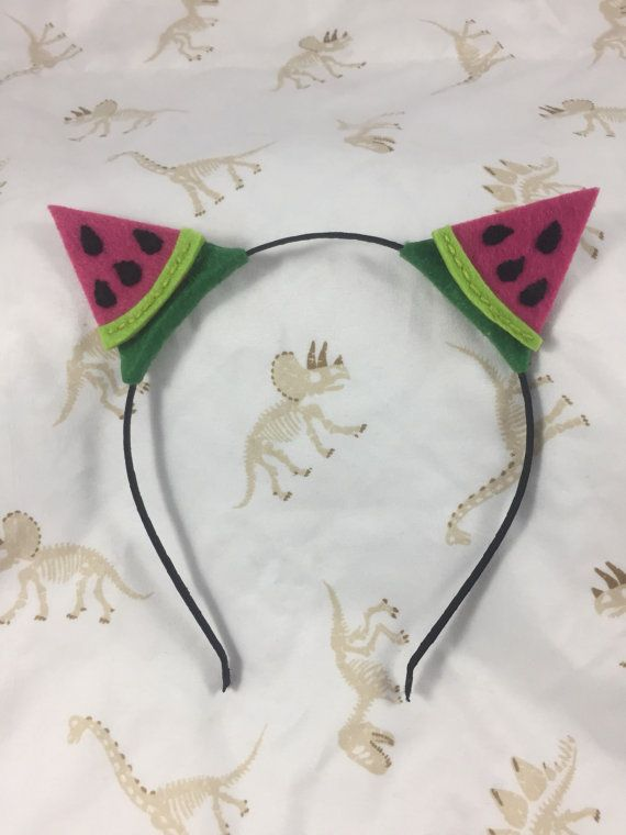 Super cute hand stitched watermelon cat ears. Securely mounted on discreet black headband.
