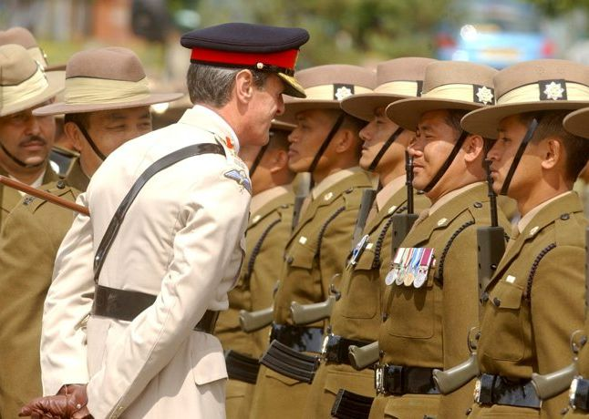 Major General Shirreff, the General Officer Commanding 3 (United Kingdom) Division, talks to a Gurkha who is proudly displaying his medals.  Gurkha soldiers of The Queen's Own Gurkha Logistic Regiment, on parade for the ceremony of Kasam Khane (the swearing of the oath of allegiance to the Queen and Regiment by recruits) and the re-titling of 1 Transport Squadron. The parade took place at their base, New Normandy Barracks in Aldershot.