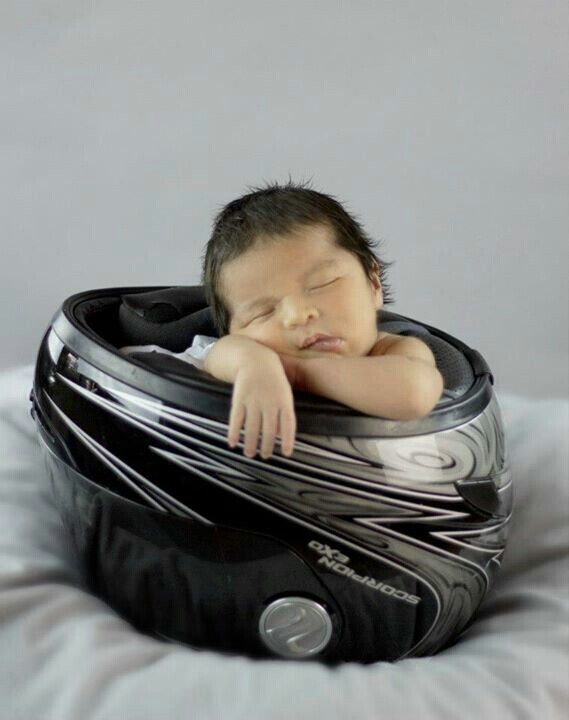 Another one for baby Sara.  Jim Goad, Thad Goad, and Maria Goad. Newborn in motorcycle helmet
