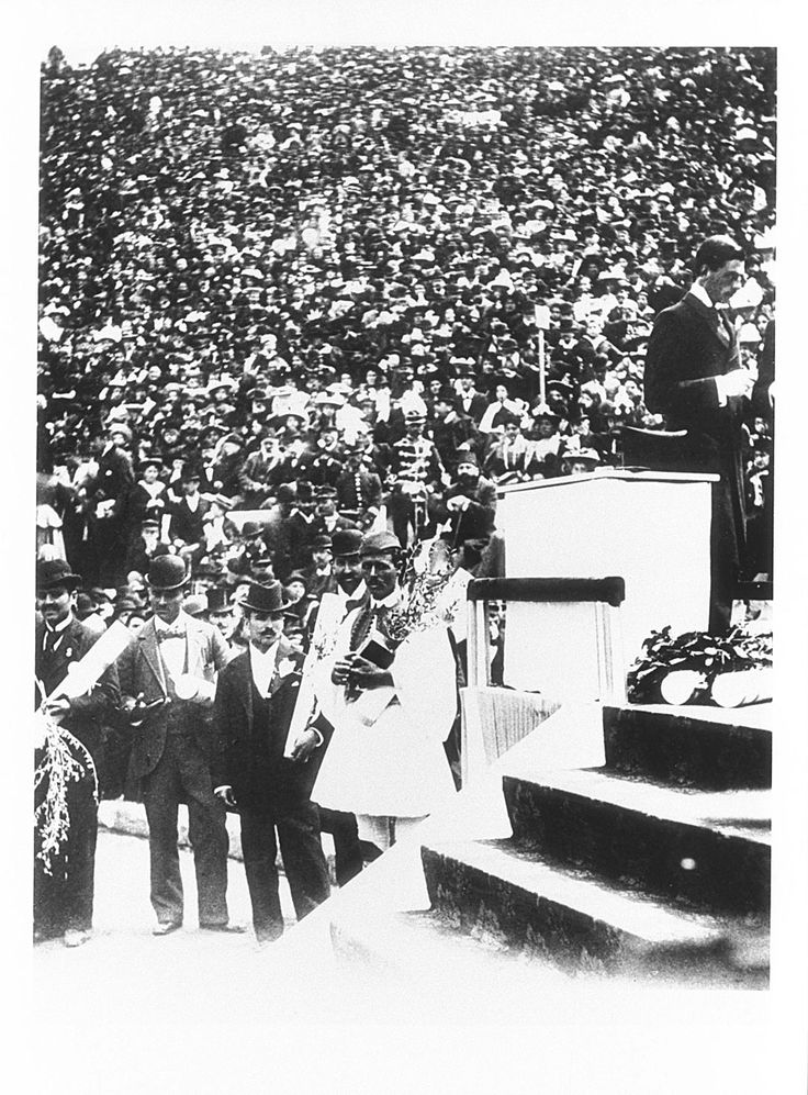 Spyridon Louis, in the centre dressed as an Evzone, at the medal ceremony for the marathon at the Athens 1896 Games. This shepherd gave Greece its first gold medal of the modern Olympic Games. The stir around this victory followed him his whole life, so much so that he was selected as flag-bearer of the Greek delegation at the Berlin Games in 1936. Olympics