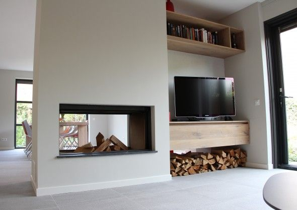 Space division on one side of a double-sided fireplace