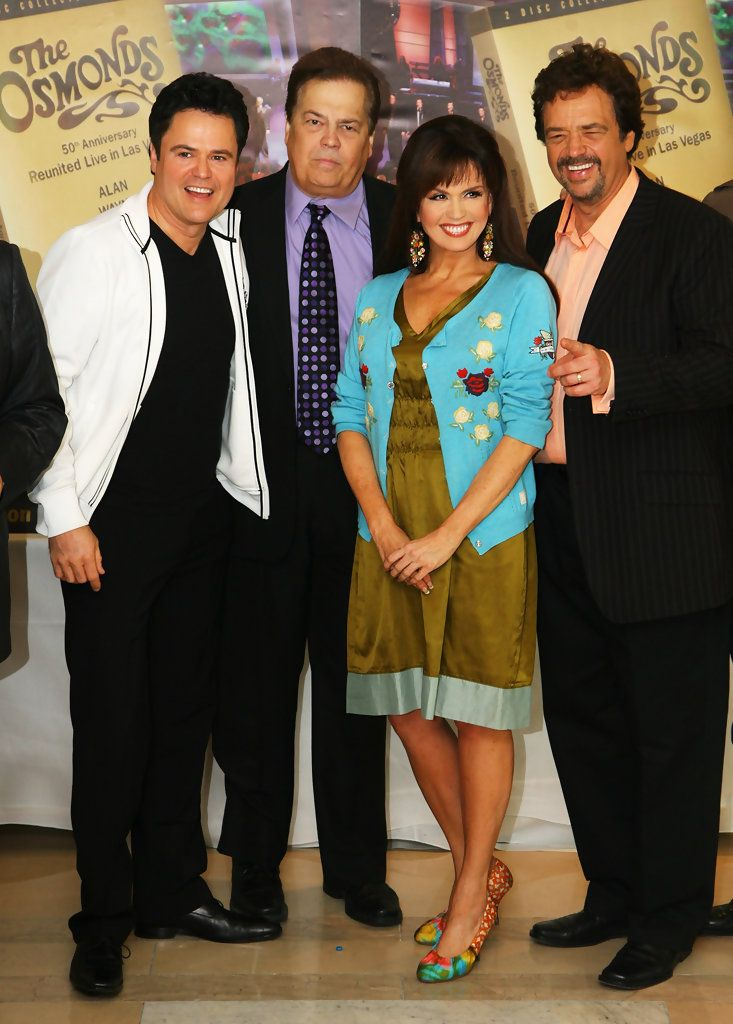 Osmonds, (L-R) Donny, Alan, Marie and Jay pose for a photograph at a photocall promoting their number one DVD and 50th Anniversary Concert in Las Vegas at the Millenium Hotel on May 29, 2008 in London, England.