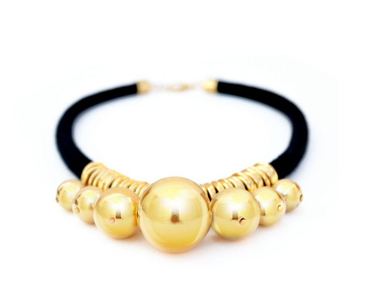 Ablack Japanese cotton cord and rings necklace with small to large gradient size gold plated resin beads. A great black and gold ropestatement necklace. Perfe