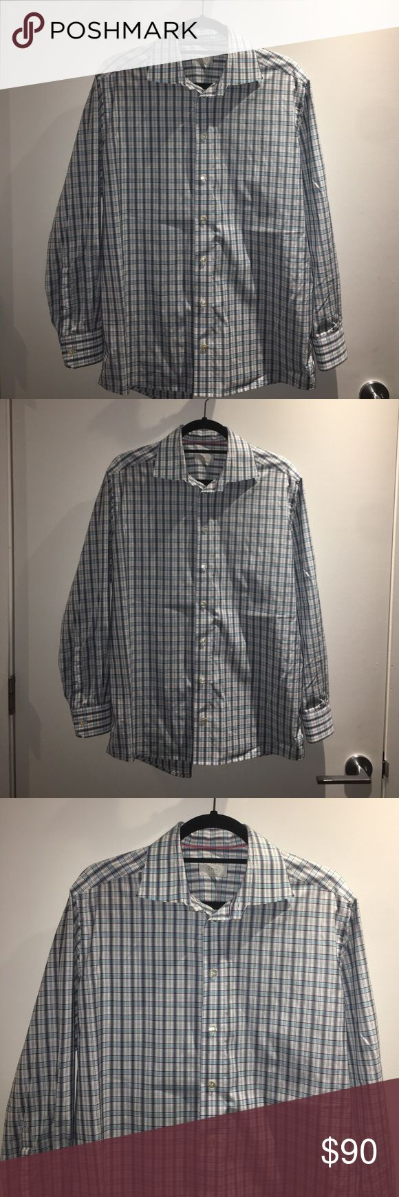 """ETON Dress Shirt ETON Dress Shirt Contemporary. Size says 16/41 but the sleeves were hemmed and measure 28"""". The colors of the shirt are navy blue, light blue, and white. Excellent, like new condition. Retails $285. 100% cotton. Made in Sweden. Machine wash. Eton Shirts Dress Shirts"""