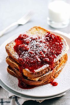 Eggnog French Toast topped with a homemade Honey Raspberry Sauce. @Pinch of Yum