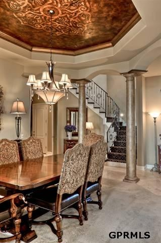 Tuscan dining set and inspiring ceiling. Love the staircase coming into the room