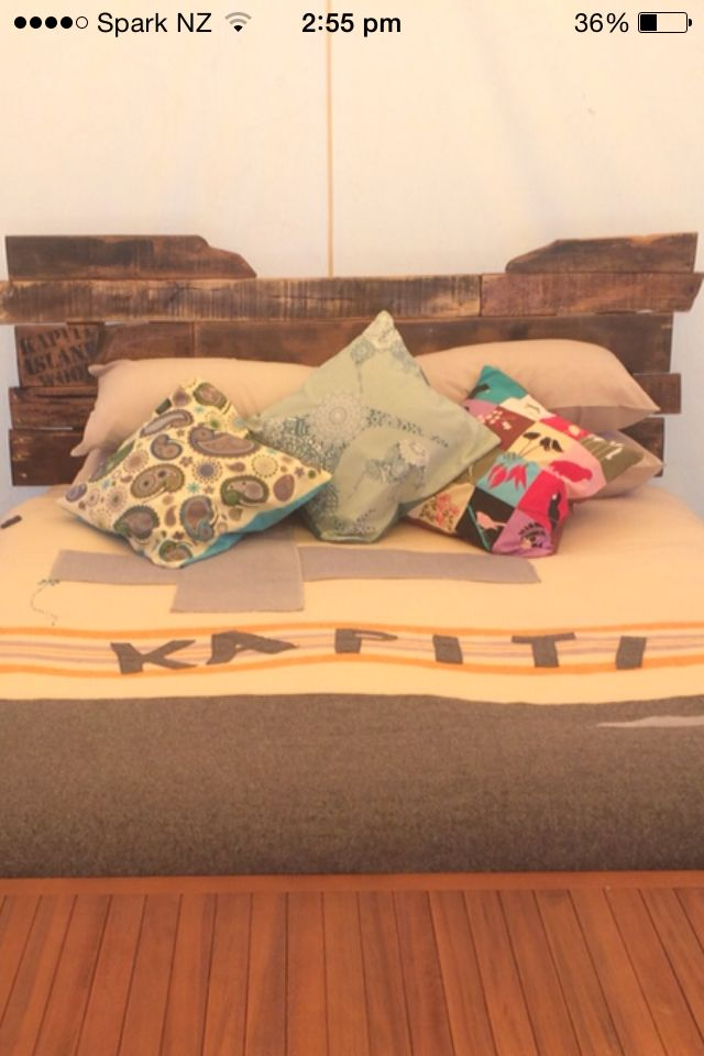 Rustic headboard made from upcycled pallets