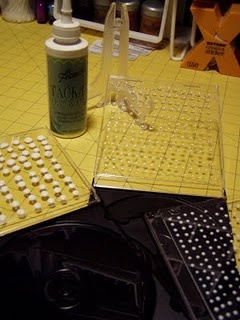 """Make your own glue dots: Using Aleene's """"Tack-It Over and Over"""" glue, make dots in any size or shape on the inside cover of an empty CD cover. Let dry. Peel off as needed."""