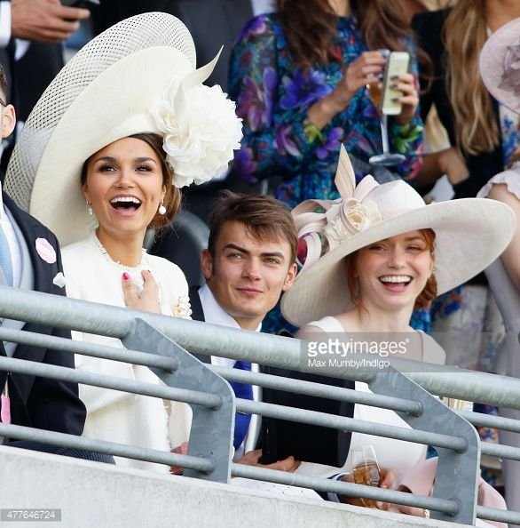 Samantha Barks, Ben Atkinson and Eleanor Tomlinson watch the racing as they attend day 3, Ladies Day, of Royal Ascot at Ascot Racecourse on June 18, 2015 in Ascot, England.
