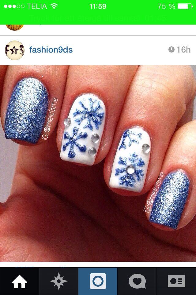 Vita och blå snöflingor