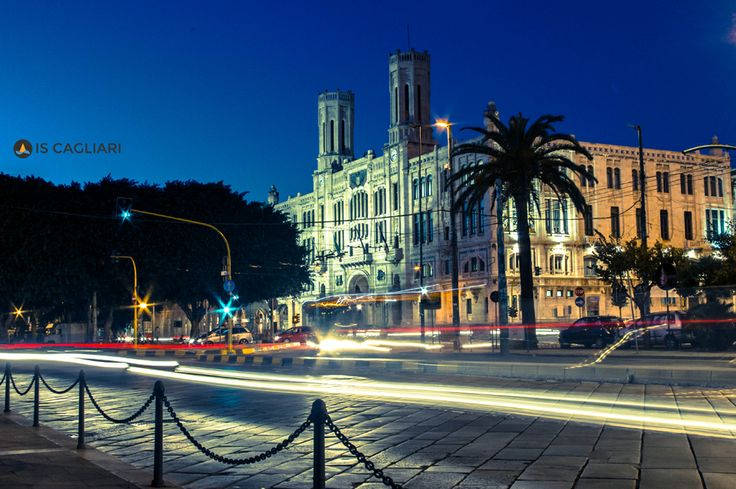 """A night view of the town hall in """"Via Roma""""."""