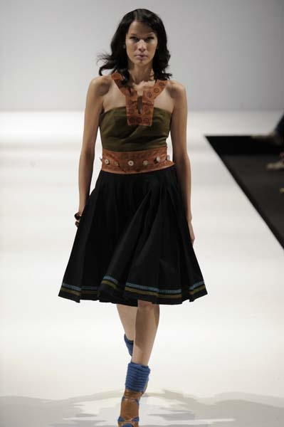 Sami inspired fashion;  Black pleated skirt with reindeer leather belt.