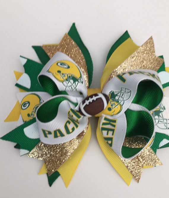 Green Bay Packers Football Layered Hair Bow This handmade Bow measures approx. 5 inches wide ( great for infants, toddlers, big girls, teens and adults). Bow comes securely attached an alligator clip. All ribbons ends have been heat sealed to prevent fraying. Like my Facebook page and follow my work!! www.facebook.com/AurorasChicBowtique Instagram: auroras_bowtique