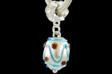 turquoise glass and red decorations, oval shape, with silver foil. Lenght mm. 15.