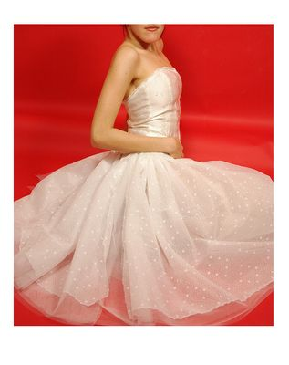 Embroidered cream corset and ballerina skirt with dots.