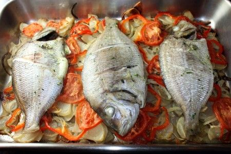 Steam baked porgy over potatoes peppers and onions fish for Porgy fish recipe