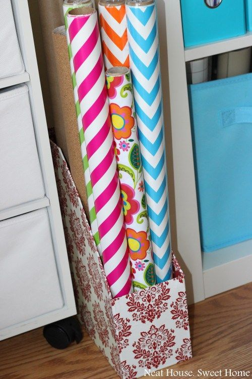 5 Craft Room Oganization Tips. Wrapping paper contained with magazine holder. Good ideas here!