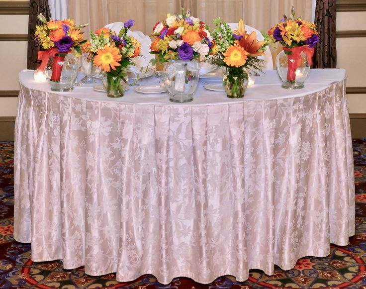 A traditional display for the bridal party flowers at the reception at Doubletree Hotel.