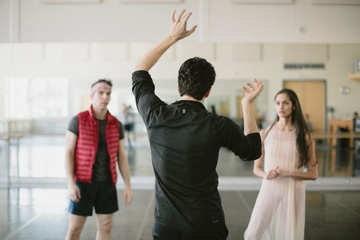 Guillaume Côté works with First Soloists Dylan Tedaldi and Tanya Howard during rehearsal for Le Petit Prince. Photo by Karolina Kuras.