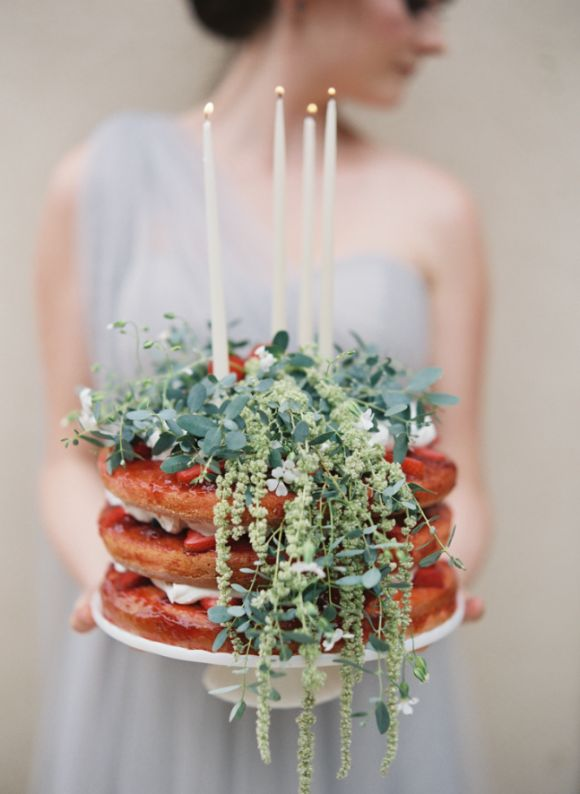 naked berry wedding cake + tapered candles