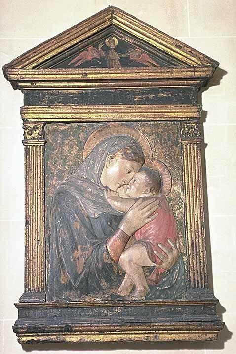 """Bottega de Donato di Niccolo BARDI dit DONATELLO Florence, vers 1386 - Florence, 1466  La Vierge et l'Enfant (""""Madone des Pazzi"""")  Stuc (gesso) polychrome dans un encadrement orné d'une représentation de Dieu le Père H. : 0,70 m. ; L. : 0,53 m."""
