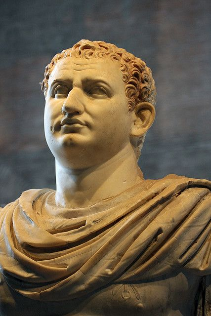"""The Flavian emperor Titus (C.E. 79-81). Found in the so-called """"basilica"""" Herculaneum, now in the Naples Museum (photo from the """"Divus Vespanianus"""" exhibit, 2009, Curia, Roman Forum). The full portrait depicts the emperor in a chestplate (cuirass) and cloak."""