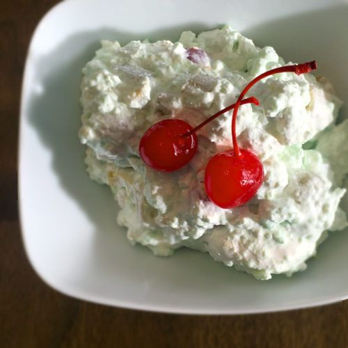 Retro 7 Up Salad with lime jello, marshmallows, and cream cheese.