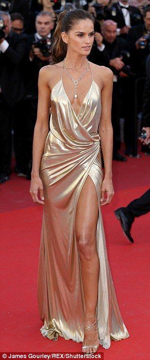 Golden girl!Izabel Goulart showed off every inch of her model frame in a plunging gold go...
