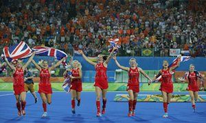 Great Britain players celebrate after Hollie Webb's decisive penalty.