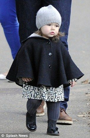 October 22: Bonpoint ecru beanie, £99, and Burberry wool cape, £195. The dress is also Bonpoint, £103, and so are the tights. Zara boots, £29.99. Total spend £464.99