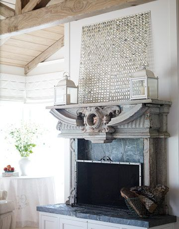 salvaged cast stone window mantel used for fireplace with slate surround