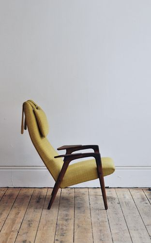 ruster armchair (1958) by yngve ekstrøm.  I have a vintage Dux chair by Folke Olssen that has that exact, loose headrest design. The pigtails on the back seem to be counter-weighted with sand, or somethingorother. File for ref.