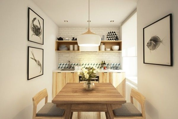 A small kitchen/dining area feels big with plenty of sunlight and white brick walls.  Love the X-Ray wall art