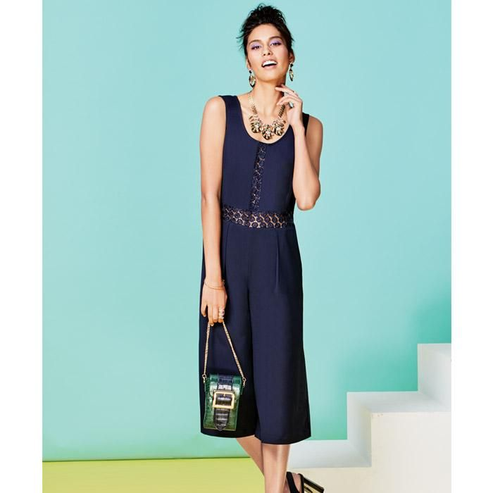 Blue Cropped Jumpsuit.with a peekaboo lace down the front and around the  middle.