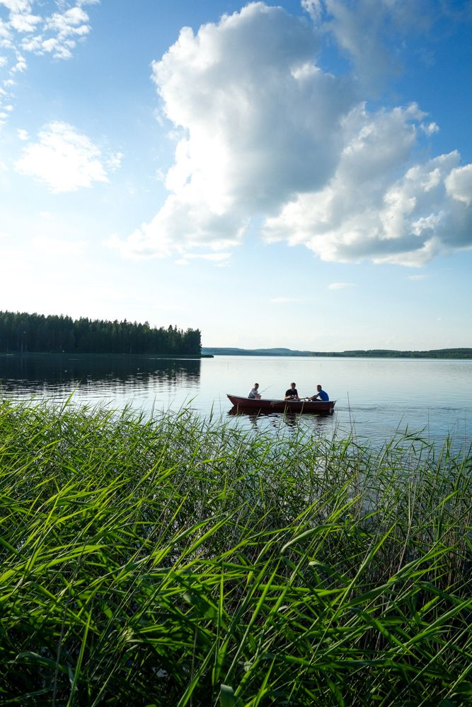 Three men in a boat at Simpele lake, next to the Russian border.