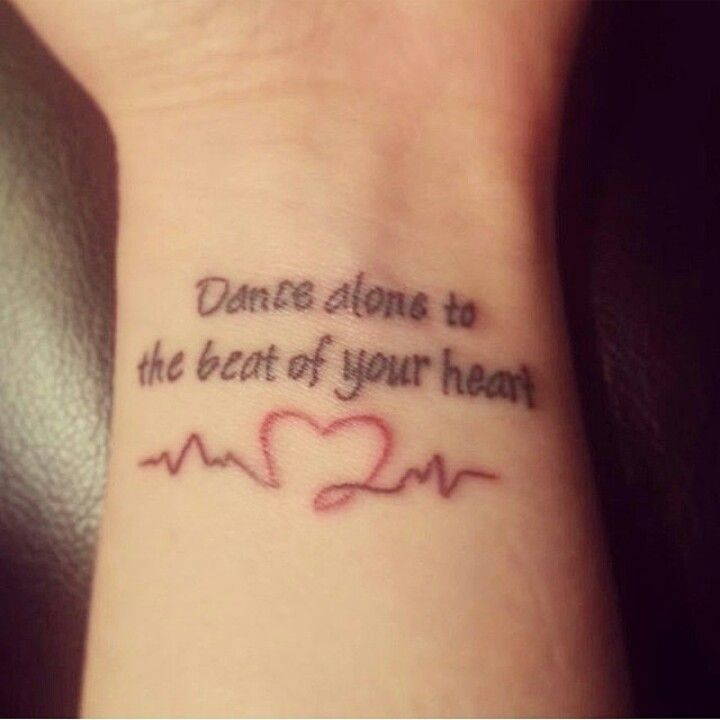 """Dance alone to the beat of your heart. Lyrics from the Fall Out Boy song """"The Phoenix"""" put into a tattoo, plus a heart on a heartbeat line on the wrist."""
