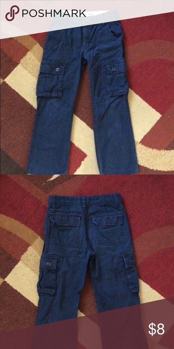 "Boy's Cargo Pants Size 7 Excellent shape Boy's old navy cargo pants size 7  Color navy blue Inseam 20.75"" Outseam 28.5"" Front waist 11.75""  Adjustable waist, belt loops, zipper & a button closure on front 2 pockets front, 2 pockets back & a pocket both sides  100% Cotton made in Bangladesh Machine washable From smoke & pet free home No holes & no stain Bundle for less & have a great day! Old Navy Bottoms Casual"