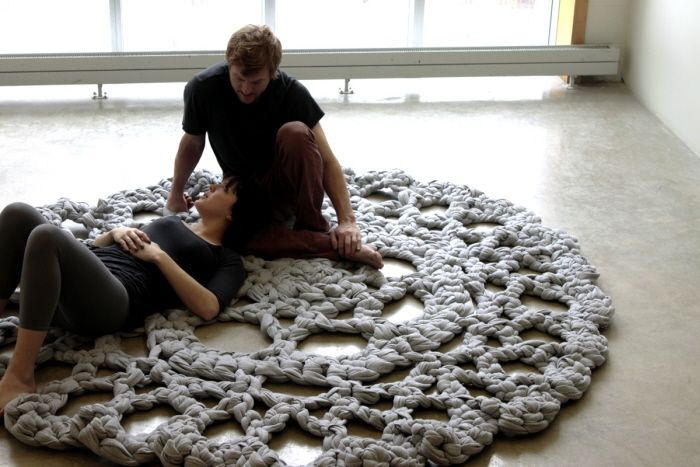 Kristina Gerig,  hand crocheted doily measuring eight feet in diameter. a homogenizing surface. made from strips of fleece... wonder how that washes...felt anyone??