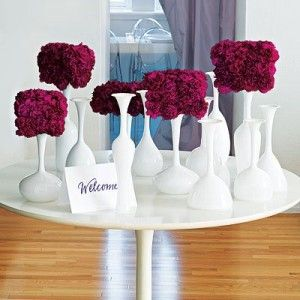 Unique centerpieces, white vases with colorful floral