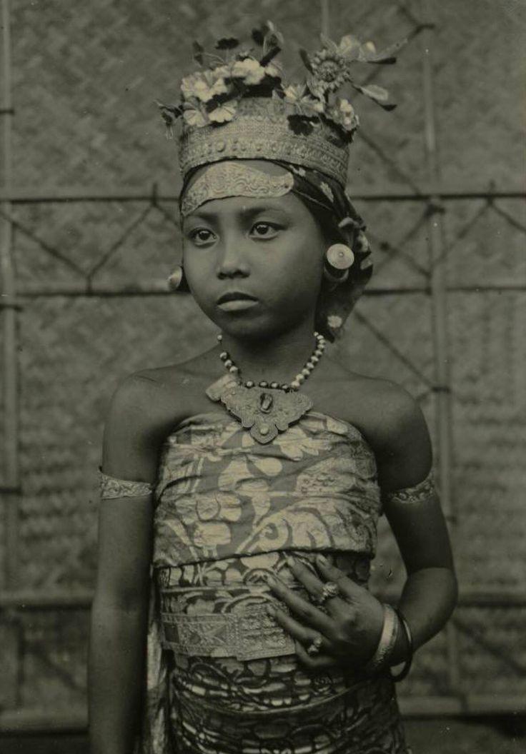 Photo of a girl from a girl group who were performing a Rejang Dewa dance ritual. Circa 1900. Badung. Bali.