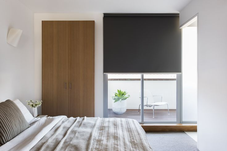 Roller Blind in Zen Blockout – Oxide fabric.                                                                                                                                                     Window Furnishing: Roller Blinds                                                                                                                                                     Room: Bedroom