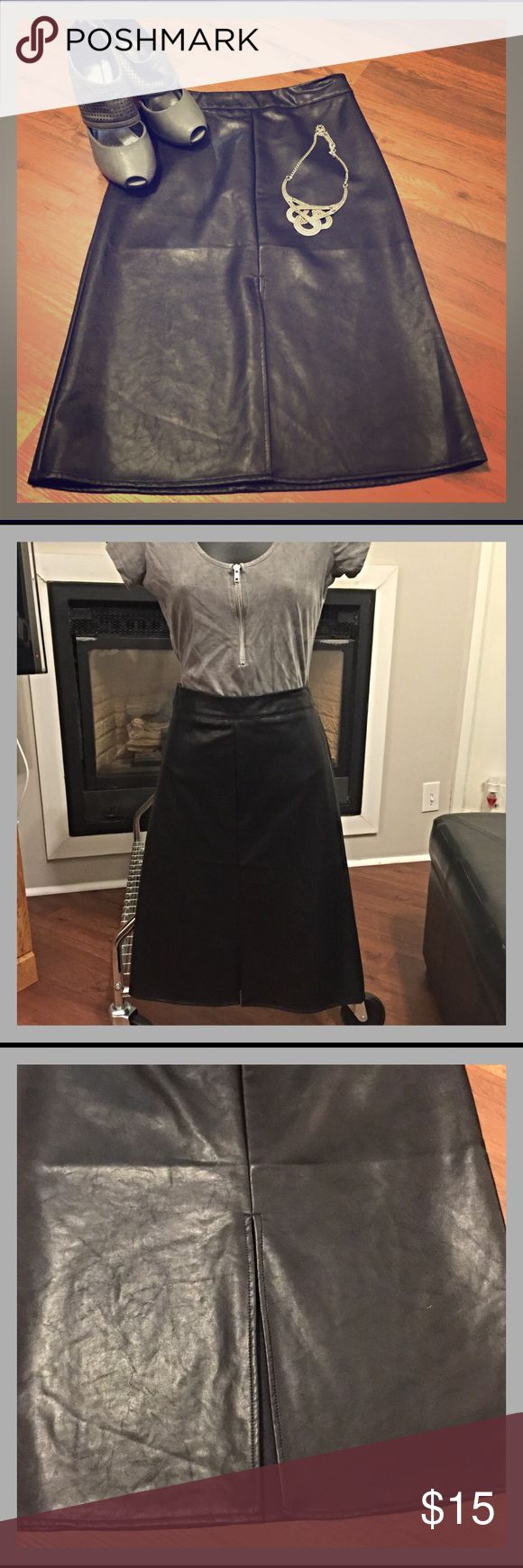 F21 NWOT Faux Leather A Line Skirt F21 NWOT - never worn. A line with a front slit.  She'll is 100% rayon.  Lining is 90% polyester, 10% spandex.  🌟 TOP RATED SELLER 🌟 FAST SHIPPER 🌟 Forever 21 Skirts A-Line or Full