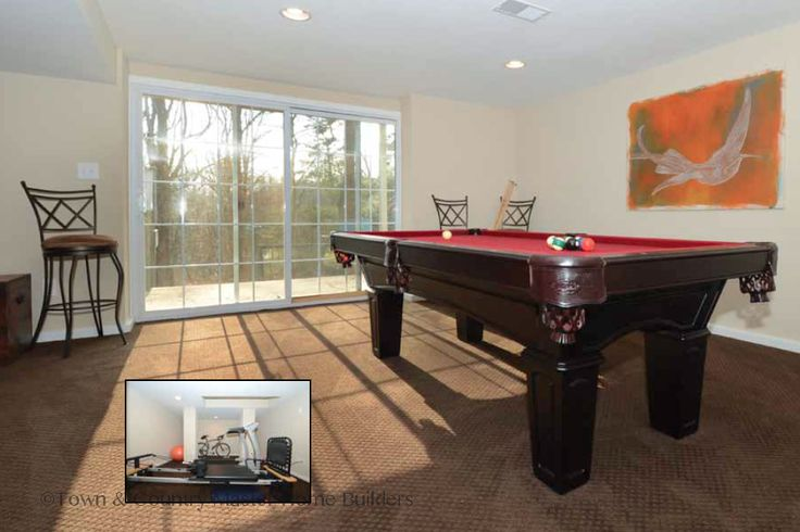 Pool table and fitness center with a sliding door to the outside! Learn more at www.tchomebuilders.com