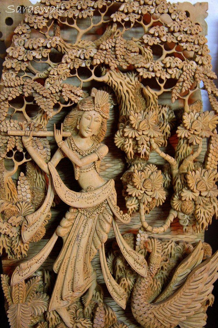 SARASWATI, goddess of learning, arts, etc Woodcarving from Mas / Ubud region.  ---Photo by Jas, 1997.